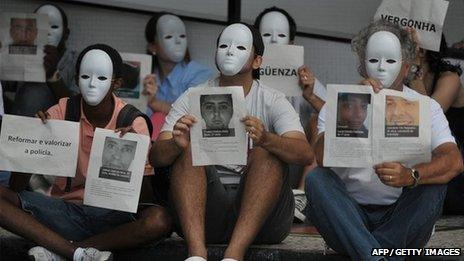 Members of the anti violence group Paz de Rio protest against the increase of the murder rate in Brazil, during the draw for next June's Confederations Cup Brazil 2013