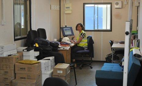 Head teacher sits at a desk in her on-site office