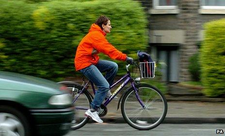 Woman cycling in Cambridge