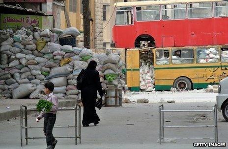 Makeshift protection against snipers in Bustan al-Kasr