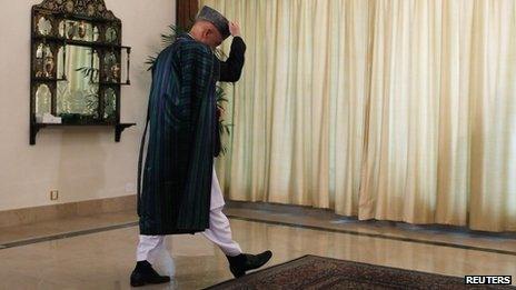Afghan President Hamid Karzai in Islamabad on 26 August 2013