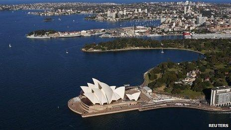 The Sydney Opera House is seen in front of some of the eastern suburbs on a sunny winter afternoon in Sydney, 24 August 2013