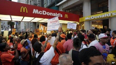 Protesting fast food workers demonstrate outside a McDonald's restaurant on New York's Fifth Avenue 29 August 2013