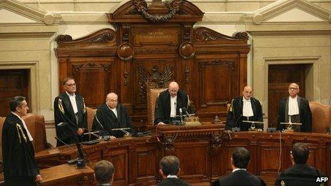 President of the Italian supreme court Antonio Esposito (C) reads the sentence at the end of the trial involving former Italian Prime Minister Silvio Berlusconi, on 1 August, 2013, at the Court of Cassation in Rome.