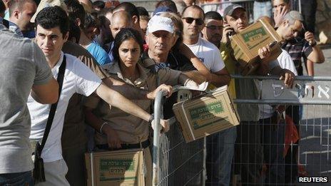 queue in Haifa of Israelis waiting for gas masks