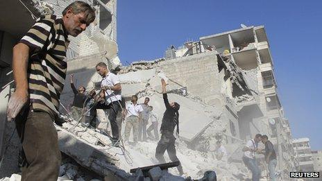 """Men search for survivors amid rubbles of collapsed building after what activists said was shelling by forces loyal to Syria""""s President Bashar al-Assad in Aleppo""""s Fardous neighborhood August 26, 2013"""