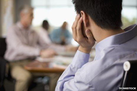 Back of man's head in meeting