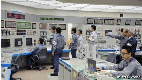 Workers of Kansai Electric Power Co's Ohi nuclear power plant monitor the restart of the No 3 unit in Ohi, Fukui prefecture, in this file photo taken by Kyodo on July 1, 2012