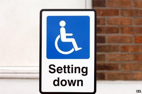 """Wheelchair icon in sign reading """"Setting Down"""""""