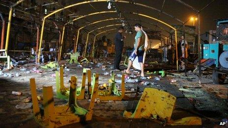 People inspect the site of a double suicide bomb attack, in the Shiite neighborhood of Sadr city in Baghdad, Iraq on 21 September 2013