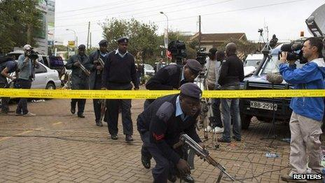 Security officers cross cordon on 23 September 2013