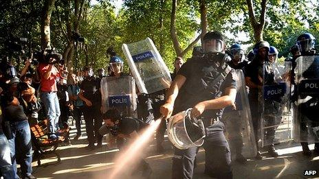 Riot police use tear gas to disperse demonstrators in Gezi Park. 8 July 2013