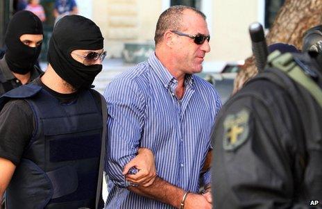 Nikos Michos under police escort in Athens, 1 October 2013