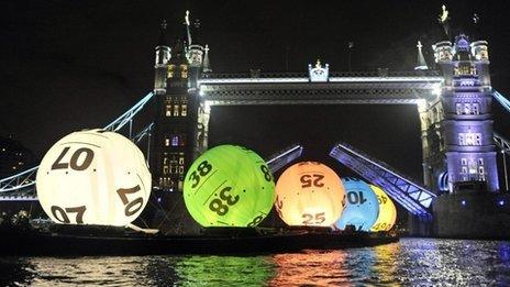 Lottery balls float down the Thames