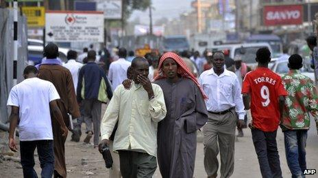 Residents of Eastleigh, a neighbourhood of Nairobi known for its densely Somali origin population, walking in Eastleigh on 18 January 2010