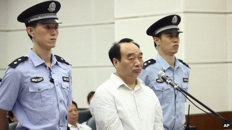 File photo: Lei Zhengfu, centre, former Communist Party chief of Chongqing city's Beibei district, who was involved in a sex tape scandal