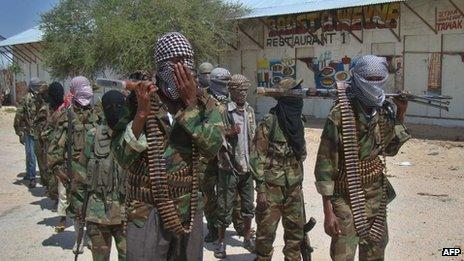 Al-Shabab recruits walk down a street in Mogadishu on March 5, 2012