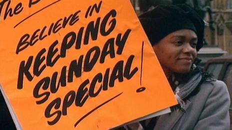 A protester holding a banner in support of the Keep Sunday Special campaign