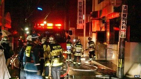Fire fighters attempt to contain a fire at a hospital in Fukuoka, western Japan on 11 October 2013
