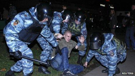 Special anti-riot police arrest a protester in Moscow