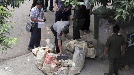 Police examine a suspected bomb package in Rangoon