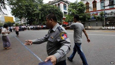 A policeman seals off a road in central Rangoon