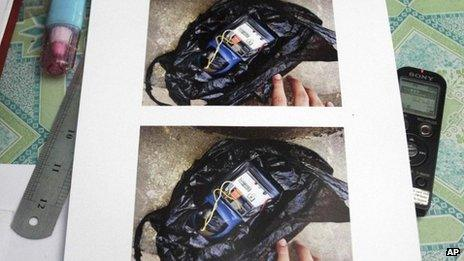 A homemade time bomb in a plastic bag found at a restaurant is displayed at a police station in Yangon Myanmar