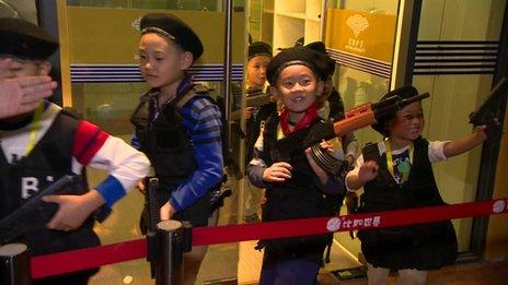 "Young boys dress as security guards at the ""I Have a Dream"" theme park in Beijing October 2013"