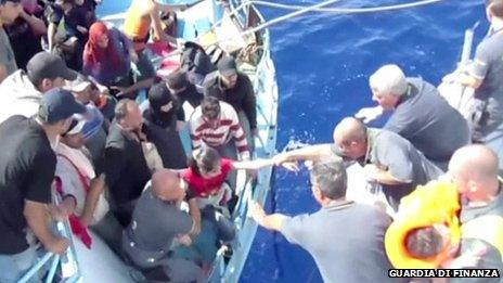 Italian Coast Guard units taking part in a search and rescue operation near the coast of the Italian island of Lampedusa