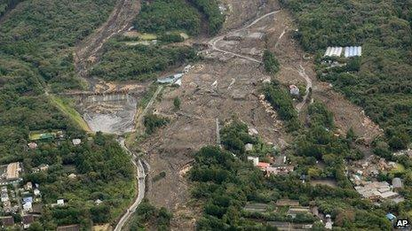 Houses in a residential area in Oshima are buried by mudslides after a powerful typhoon hit Izu Oshima island on 16 October 2013