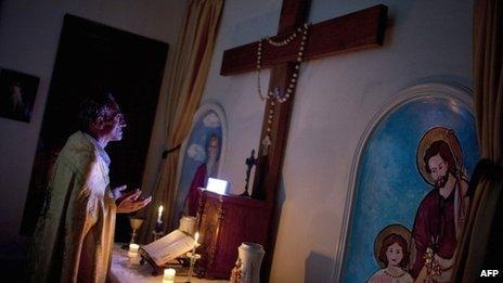 A Syrian Christian priest prays at Mar Elias House, a church hostel for the elderly in Aleppo (20 September 2013)