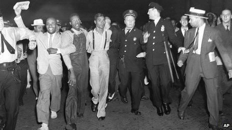 1937 file photo, police escort two of the five recently freed Scottsboro Boys
