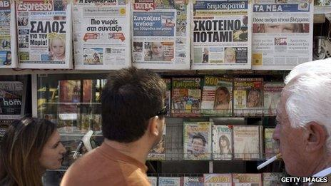 People walk past newspapers on a stand which feature front pages reporting on the story a four-year-old girl Maria, 21 October