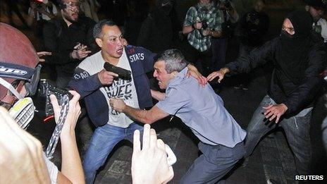 Police colonel rescued from crowd. 25 Oct 2013