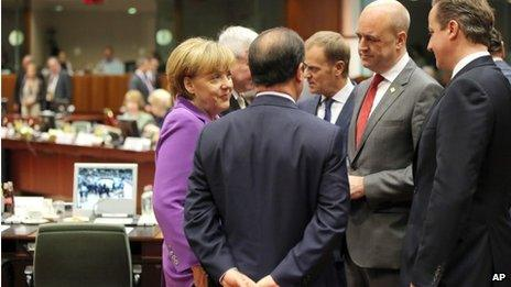 """From left clockwise, German Chancellor Angela Merkel, Czech Republic""""s Prime Minister Jiri Rusnok, Polish Prime Minister Donald Tusk, Swedish Prime Minister Fredrik Reinfeldt, British Prime Minister David Cameron and French President Francois Hollande speak with each other during a round table meeting at an EU summit in Brussels on Friday"""