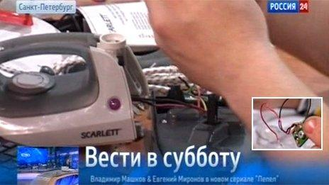 """Screengrab from Rossiya 24, with inset of the """"hidden chip"""""""