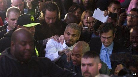 Chris Brown (centre) left court on 28 October