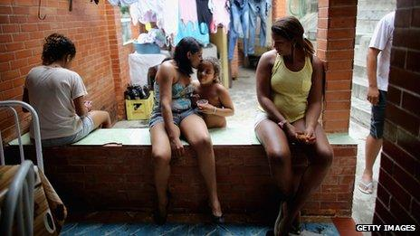 Members of the Das Neves family sit in their home in the Prazeres favela on 19 October, 2013