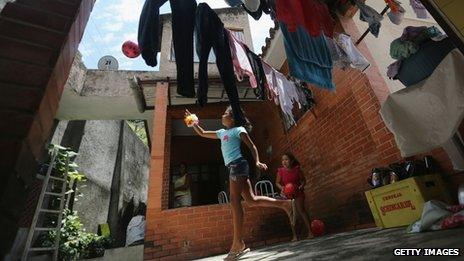 Members of the Das Neves family play in their home in the Prazeres favela on 19 October, 2013