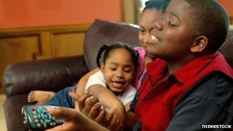 Children fight over the remote