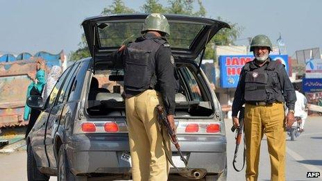 A Pakistani policeman searches a vehicle along a street in Peshawar on 2 November 2013 following the killing of Taliban leader Hakimullah Mehsud in a US drone attack in the Pakistan tribal region