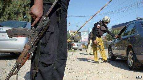 A Pakistani policeman checks a commuter at a security checkpoint in Peshawar on 2 November 2013 following the killing of Taliban leader Hakimullah Mehsud in a US drone attack in the Pakistan tribal region