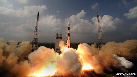 Rocket carrying the Mars Orbiter Spacecraft blasting off from the launch pad at Sriharikota
