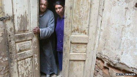 Jakob Yusef and Khalda Salih standing in a doorway