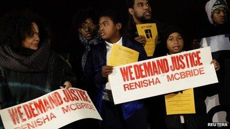 Demonstrators protest against the killing of 19-year-old Renisha McBride outside the Dearborn Heights Police Station in Dearborn Heights, Michigan 7 November 2013
