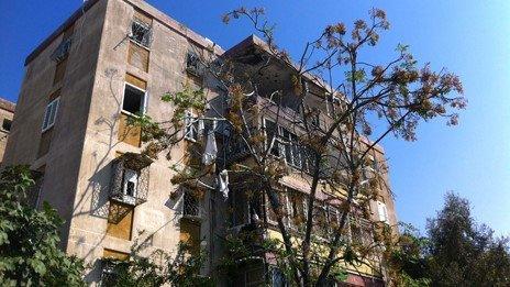 Building hit by rocket in Kiryat Malachi