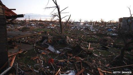 Debris covers the area after a tornado struck on 17 November 2013 in Washington, Illinois