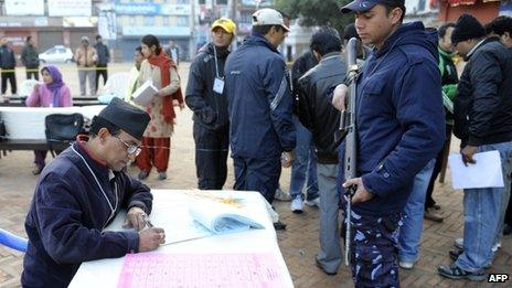 A Nepalese election official prepares ballots as voting begins at a polling station in Kathmandu on 19 November 2013