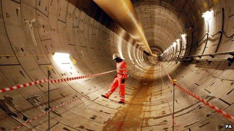 Crossrail worker Sam Agyeman, inspects the first completed section of Crossrail tunnel