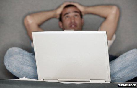 Man frustrated at keyboard